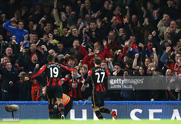 Bournemouth's English striker Glenn Murray celebrates with fans after scoring during the English Premier League football match between Chelsea and...
