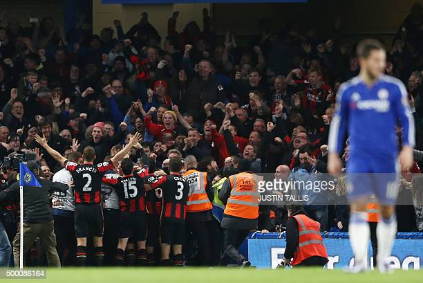 Bournemouth's English striker Glenn Murray celebrates with teammates after scoring during the English Premier League football match between Chelsea...