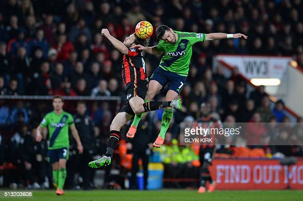 Bournemouth's Englishborn Irish midfielder Harry Arter and Southampton's Irish striker Shane Long contest a high ball during the English Premier...