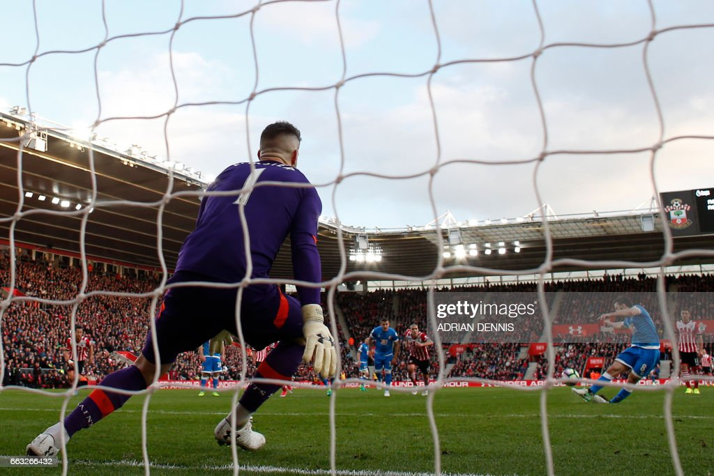 Bournemouth's English-born Irish midfielder Harry Arter (R) fires this penalty kick high over the bar during the English Premier League football match between Southampton and Bournemouth at St Mary's Stadium in Southampton, southern England on April 1, 2017. The game finished 0-0. / AFP PHOTO / Adrian DENNIS / RESTRICTED TO EDITORIAL USE. No use with unauthorized audio, video, data, fixture lists, club/league logos or 'live' services. Online in-match use limited to 75 images, no video emulation. No use in betting, games or single club/league/player publications. /