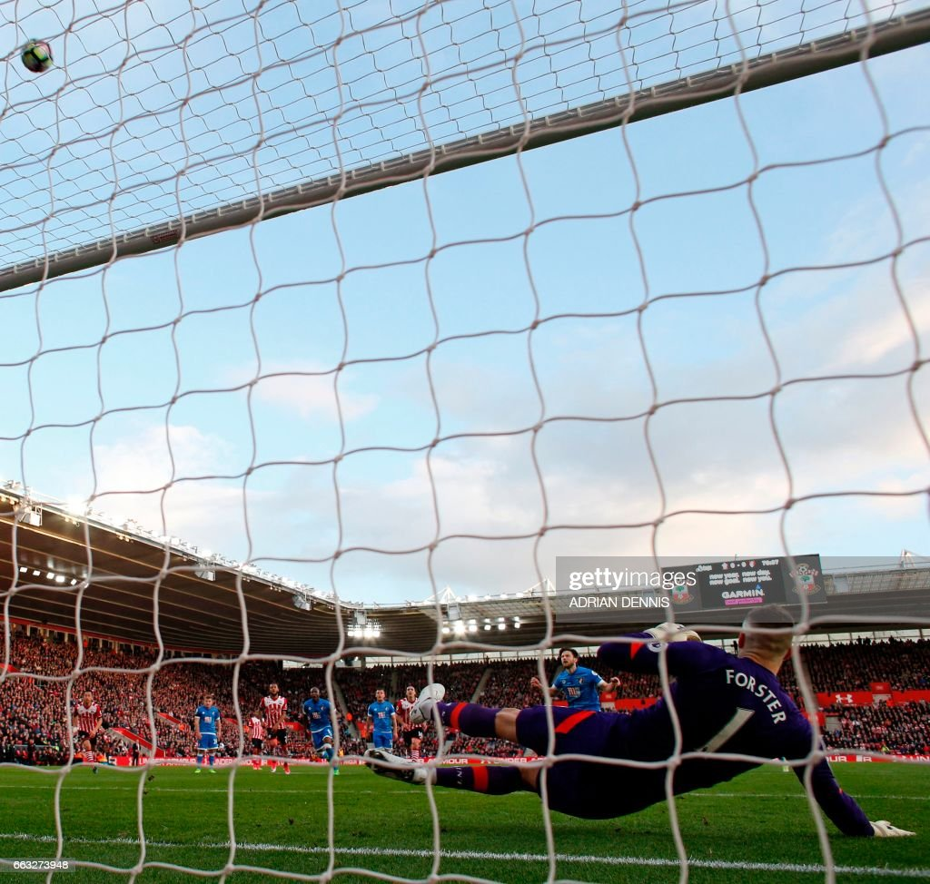 Bournemouth's English-born Irish midfielder Harry Arter (C) fires this penalty kick high over the bar during the English Premier League football match between Southampton and Bournemouth at St Mary's Stadium in Southampton, southern England on April 1, 2017. The game finished 0-0. / AFP PHOTO / Adrian DENNIS / RESTRICTED TO EDITORIAL USE. No use with unauthorized audio, video, data, fixture lists, club/league logos or 'live' services. Online in-match use limited to 75 images, no video emulation. No use in betting, games or single club/league/player publications. /