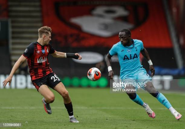 Bournemouth's English-born Welsh midfielder David Brooks vies for the ball with Tottenham Hotspur's French midfielder Moussa Sissoko during the...