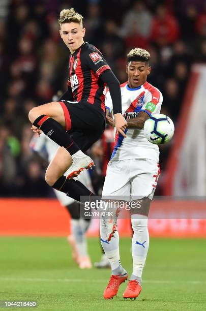 Bournemouth's Englishborn Welsh midfielder David Brooks vies with Bournemouth's English defender Steve Cook during the English Premier League...