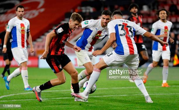 Bournemouth's Englishborn Welsh midfielder David Brooks vies with Crystal Palace's Polish defender Jaroslaw Jach during the English League Cup second...