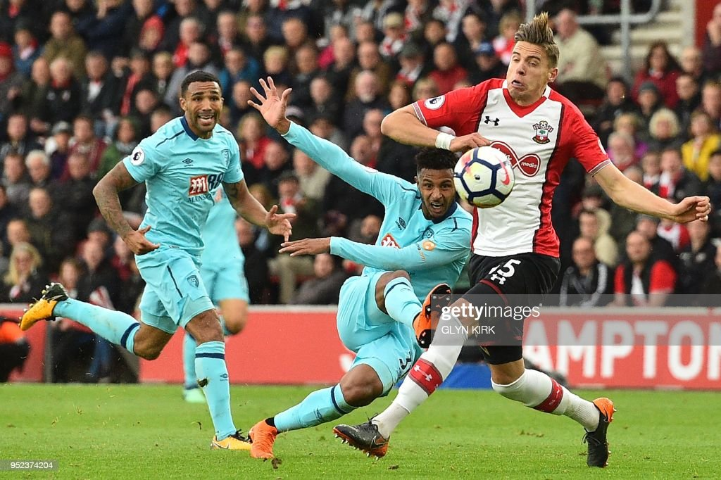 Bournemouth's French midfielder Lys Mousset (C) takes a shot during the English Premier League football match between Southampton and Bournemouth at St Mary's Stadium in Southampton, southern England on April 28, 2018. (Photo by Glyn KIRK / AFP) / RESTRICTED TO EDITORIAL USE. No use with unauthorized audio, video, data, fixture lists, club/league logos or 'live' services. Online in-match use limited to 75 images, no video emulation. No use in betting, games or single club/league/player publications. /