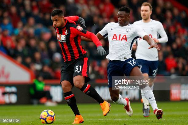 Bournemouth's French midfielder Lys Mousset vies with Tottenham Hotspur's Kenyan midfielder Victor Wanyama during the English Premier League football...