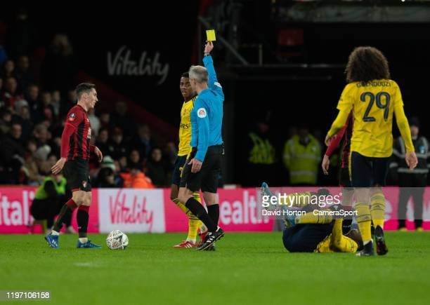 Bournemouth's Harry Wilson is shown a yellow card by Referee Martin Atkinson for a foul on Arsenal's Eddie Nketiah during the FA Cup Fourth Round...