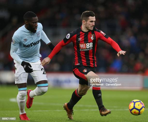 Bournemouth's Lewis Cook and West Ham United's Arthur Masuaku during the Premier League match between AFC Bournemouth and West Ham United at Vitality...