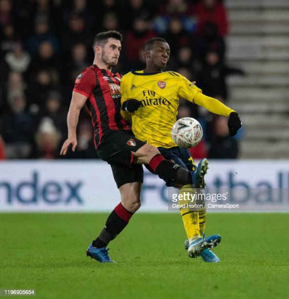 Bournemouth's Lewis Cook battles with Arsenal's Eddie Nketiah during the FA Cup Fourth Round match between Bournemouth and Arsenal at Vitality...