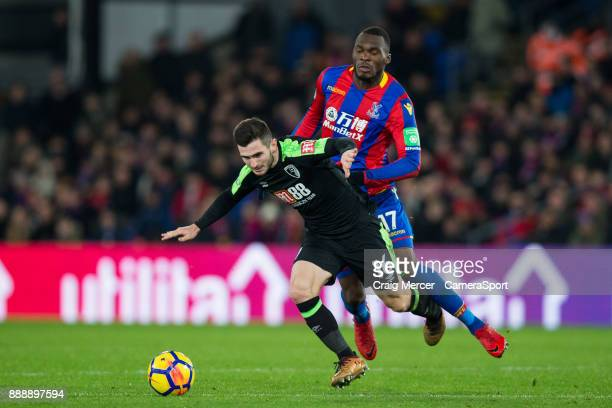 Bournemouth's Lewis Cook is fouled by Crystal Palace's Christian Benteke during the Premier League match between Crystal Palace and AFC Bournemouth...