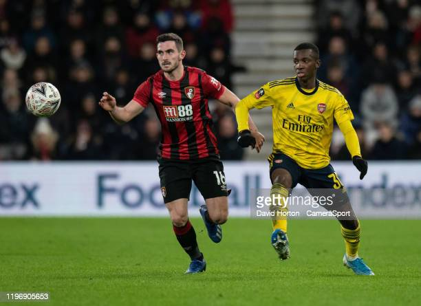 Bournemouth's Lewis Cook under pressure from Arsenal's Eddie Nketiah during the FA Cup Fourth Round match between Bournemouth and Arsenal at Vitality...