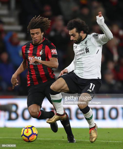 AFC Bournemouth's Nathan Ake and Liverpool's Mohamed Salah battle for the ball during the Premier League match at the Vitality Stadium Bournemouth