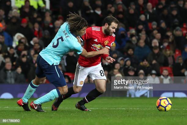 AFC Bournemouth's Nathan Ake and Manchester United's Juan Mata battle for the ball during the Premier League match at Old Trafford Manchester