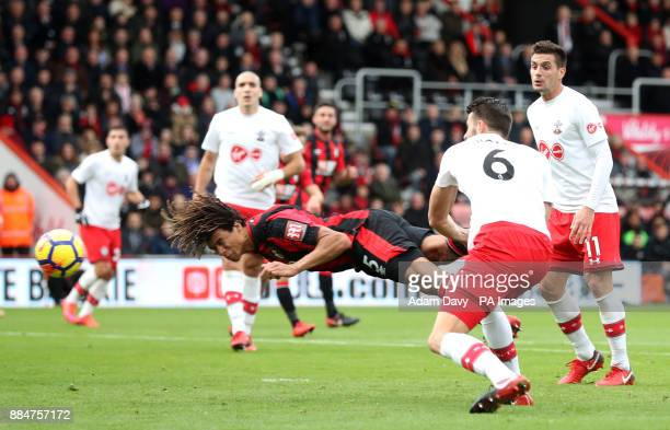 AFC Bournemouth's Nathan Ake with a diving header on goal during the Premier League match at the Vitality Stadium Bournemouth