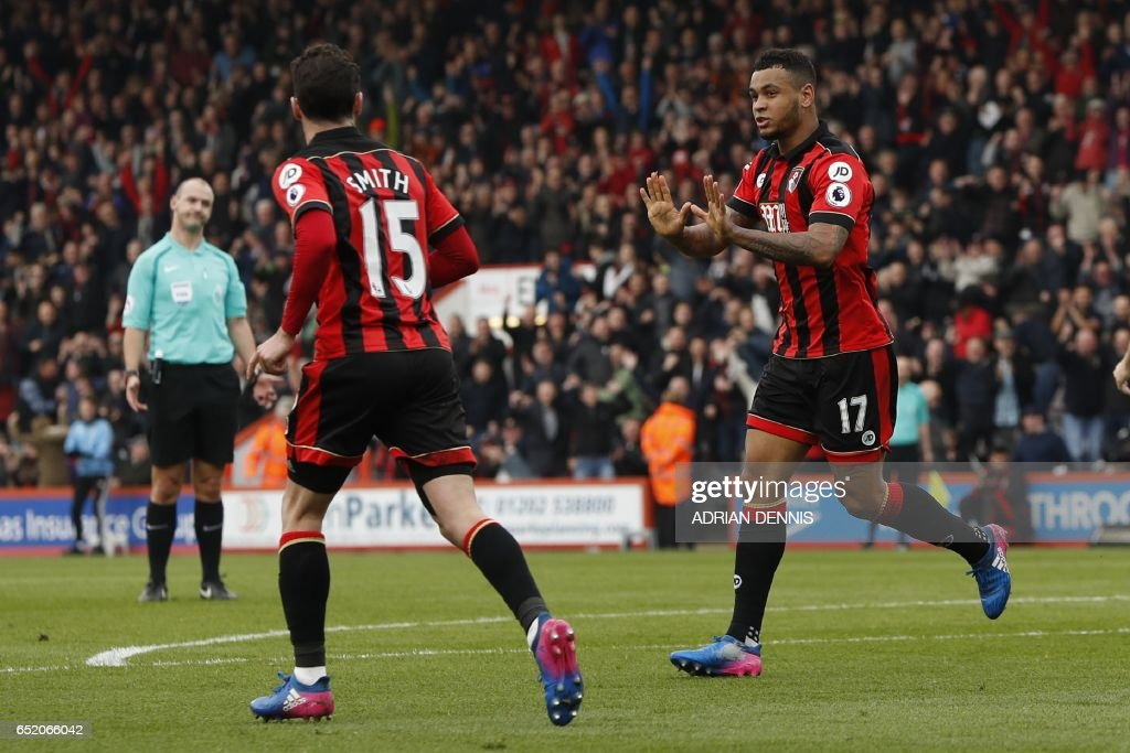 Bournemouth's Norwegian striker Joshua King (R) celebrates after scoring their first goal during the English Premier League football match between Bournemouth and West Ham United at the Vitality Stadium in Bournemouth, southern England on March 11, 2017. / AFP PHOTO / Adrian DENNIS / RESTRICTED TO EDITORIAL USE. No use with unauthorized audio, video, data, fixture lists, club/league logos or 'live' services. Online in-match use limited to 75 images, no video emulation. No use in betting, games or single club/league/player publications. /