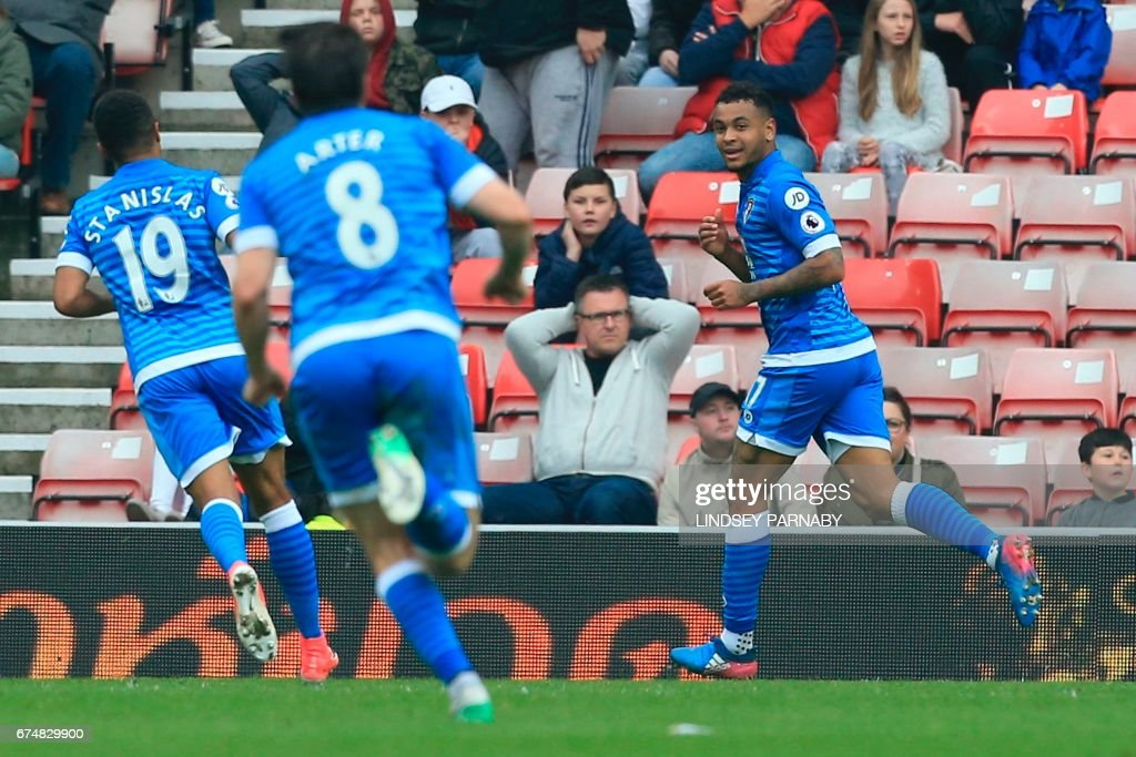 Bournemouth's Norwegian striker Joshua King (R) celebrates scoring the opening goal during the English Premier League football match between Sunderland and Bournemouth at the Stadium of Light in Sunderland, north-east England on April 29, 2017. / AFP PHOTO / Lindsey PARNABY / RESTRICTED TO EDITORIAL USE. No use with unauthorized audio, video, data, fixture lists, club/league logos or 'live' services. Online in-match use limited to 75 images, no video emulation. No use in betting, games or single club/league/player publications. /