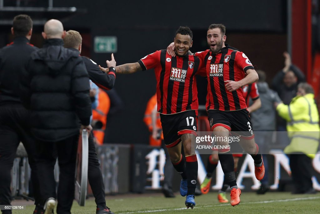 Bournemouth's Norwegian striker Joshua King (2nd R) celebrates with Bournemouth's English defender Steve Cook as he runs to Bournemouth's English manager Eddie Howe after scoring his third goal to give Bournemouth a 3-2 win in the English Premier League football match between Bournemouth and West Ham United at the Vitality Stadium in Bournemouth, southern England on March 11, 2017. Bournemouth won the game 3-2. / AFP PHOTO / Adrian DENNIS / RESTRICTED TO EDITORIAL USE. No use with unauthorized audio, video, data, fixture lists, club/league logos or 'live' services. Online in-match use limited to 75 images, no video emulation. No use in betting, games or single club/league/player publications. /