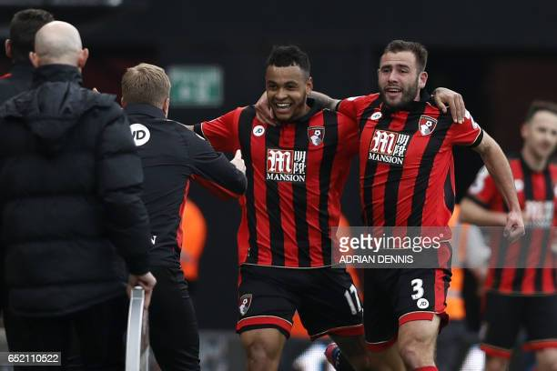 Bournemouth's Norwegian striker Joshua King celebrates with Bournemouth's English defender Steve Cook as he runs to Bournemouth's English manager...