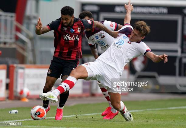 Bournemouth's Norwegian striker Joshua King fights for the ball with Southampton's Danish defender Jannik Vestergaard during the English Premier...