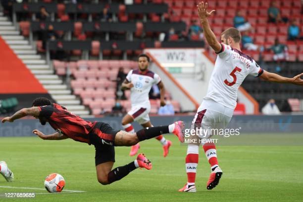 Bournemouth's Norwegian striker Joshua King is challenges by Southampton's English defender Jack Stephens during the English Premier League football...
