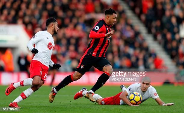 Bournemouth's Norwegian striker Joshua King runs between Southampton's Moroccan midfielder Sofiane Boufal and Southampton's Spanish midfielder Oriol...