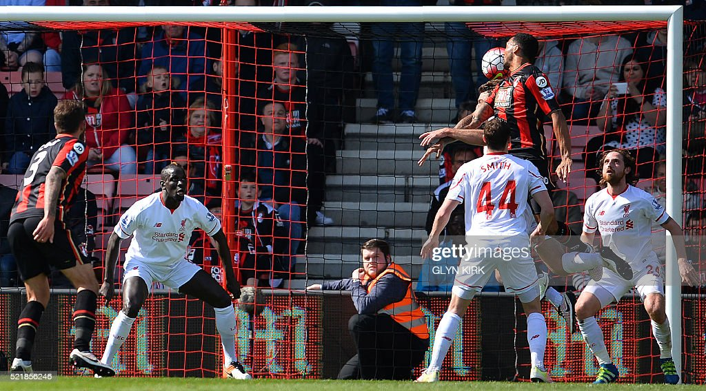 Bournemouth's Norwegian striker Joshua King (2R) scores his team's first goal during the English Premier League football match between Bournemouth and Liverpool at the Vitality Stadium in Bournemouth, southern England on April 17, 2016. Liverpool won the match 2-1. / AFP / GLYN KIRK / RESTRICTED TO EDITORIAL USE. No use with unauthorized audio, video, data, fixture lists, club/league logos or 'live' services. Online in-match use limited to 75 images, no video emulation. No use in betting, games or single club/league/player publications. /