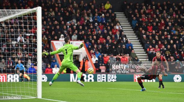 Bournemouth's Norwegian striker Joshua King scores the opening goal past Manchester United's Spanish goalkeeper David de Gea during the English...
