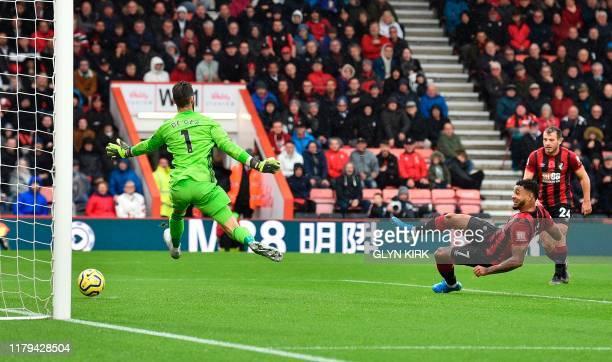 TOPSHOT Bournemouth's Norwegian striker Joshua King scores the opening goal past Manchester United's Spanish goalkeeper David de Gea during the...