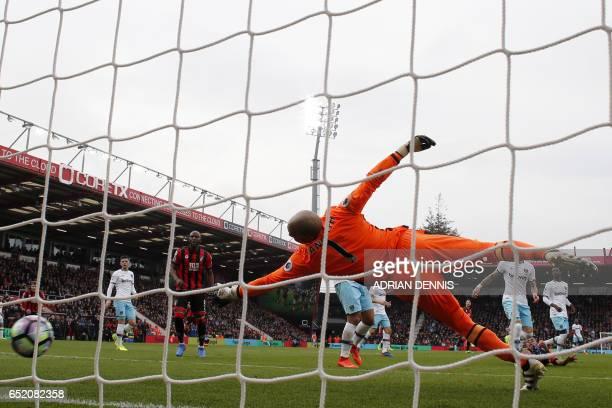 Bournemouth's Norwegian striker Joshua King scores their first goal past the dive of West Ham United's Irish goalkeeper Darren Randolph during the...