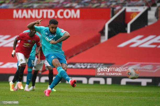 Bournemouth's Norwegian striker Joshua King shoots a penalty kick and scores during the English Premier League football match between Manchester...