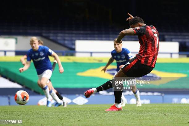 Bournemouth's Norwegian striker Joshua King shoots and scores a penalty kick during the English Premier League football match between Everton and...