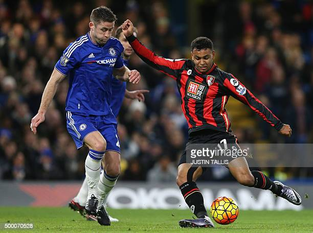 Bournemouth's Norwegian striker Joshua King shoots past Chelsea's English defender Gary Cahill during the English Premier League football match...
