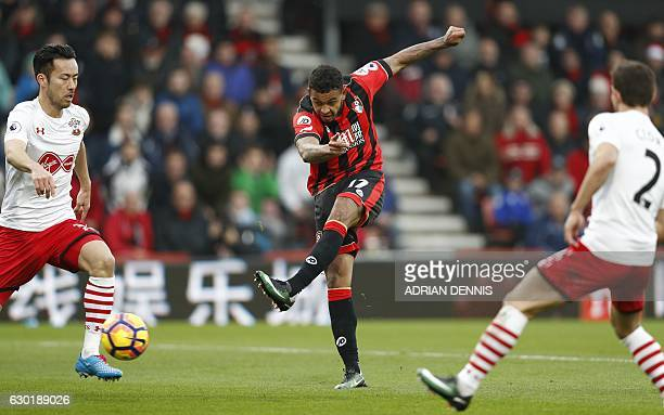 Bournemouth's Norwegian striker Joshua King shoots towards goal but is denied a goal by Southampton's English goalkeeper Fraser Forster during the...