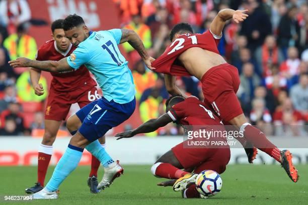 Bournemouth's Norwegian striker Joshua King vies with Liverpool's English midfielder Alex OxladeChamberlain and Liverpool's Senegalese midfielder...
