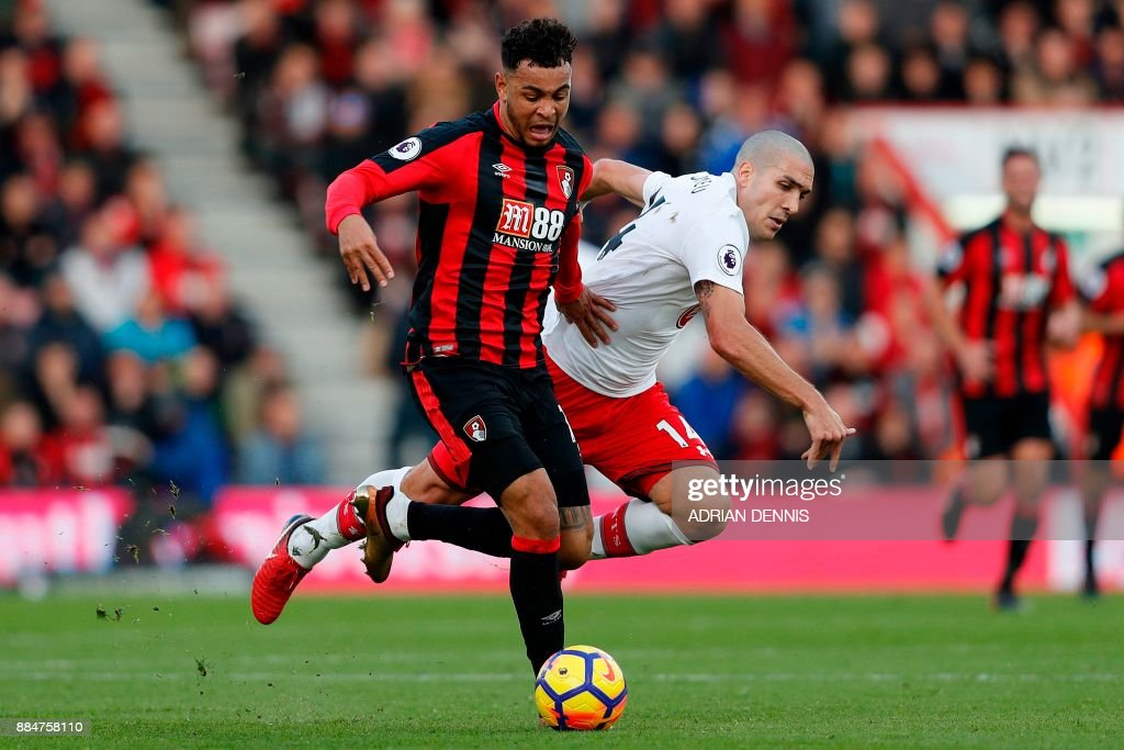 Bournemouth's Norwegian striker Joshua King (L) vies with Southampton's Spanish midfielder Oriol Romeu (R) during the English Premier League football match between Bournemouth and Southampton at the Vitality Stadium in Bournemouth, southern England on December 3, 2017. / AFP PHOTO / Adrian DENNIS / RESTRICTED TO EDITORIAL USE. No use with unauthorized audio, video, data, fixture lists, club/league logos or 'live' services. Online in-match use limited to 75 images, no video emulation. No use in betting, games or single club/league/player publications. /