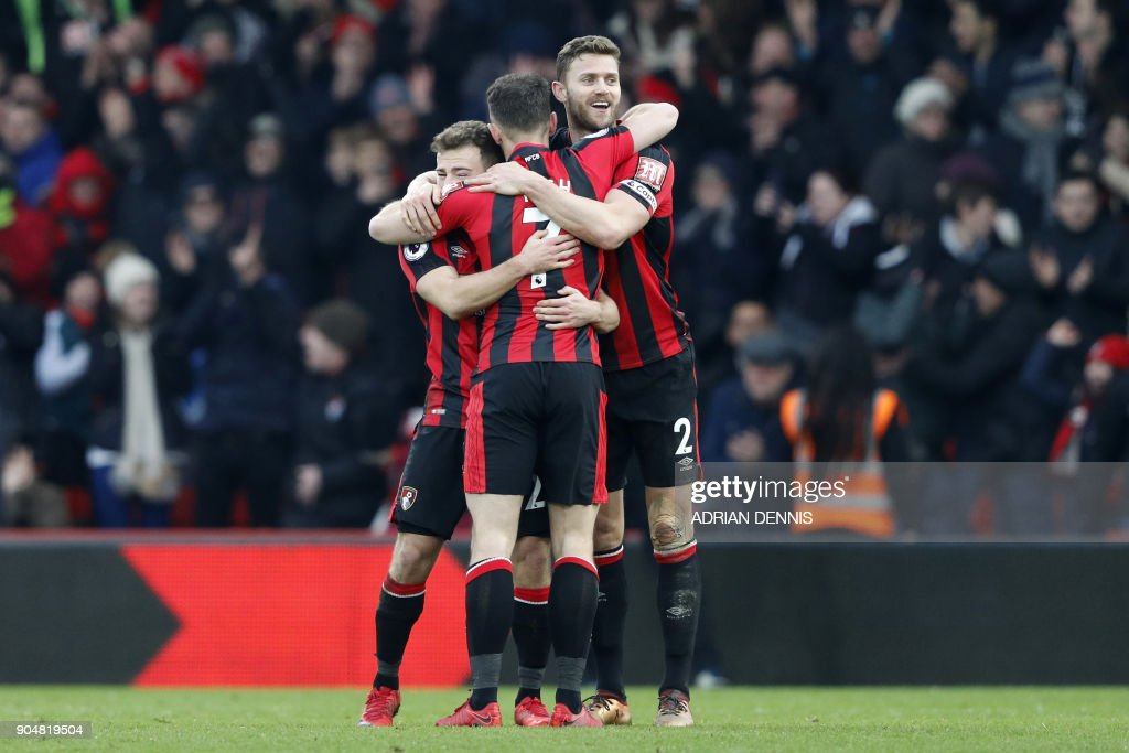 Bournemouth's players celebrate at the final whistle during the English Premier League football match between Bournemouth and Arsenal at the Vitality Stadium in Bournemouth, southern England on January 14, 2018. / AFP PHOTO / Adrian DENNIS / RESTRICTED TO EDITORIAL USE. No use with unauthorized audio, video, data, fixture lists, club/league logos or 'live' services. Online in-match use limited to 75 images, no video emulation. No use in betting, games or single club/league/player publications. /