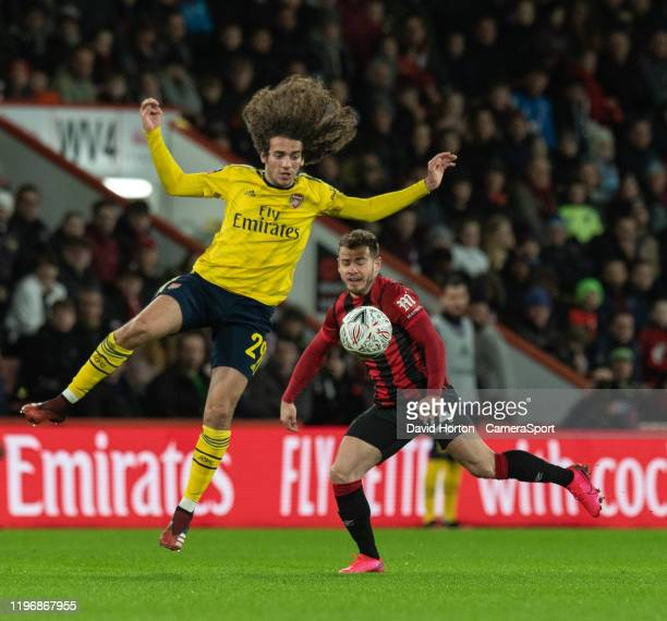 Bournemouth's Ryan Fraser battles with Arsenal's Matteo Guendouzi during the FA Cup Fourth Round match between Bournemouth and Arsenal at Vitality...