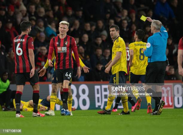 Bournemouth's Sam Surridge is shown a yellow card by Referee Martin Atkinson for a foul on Arsenal's Matteo Guendouzi during the FA Cup Fourth Round...