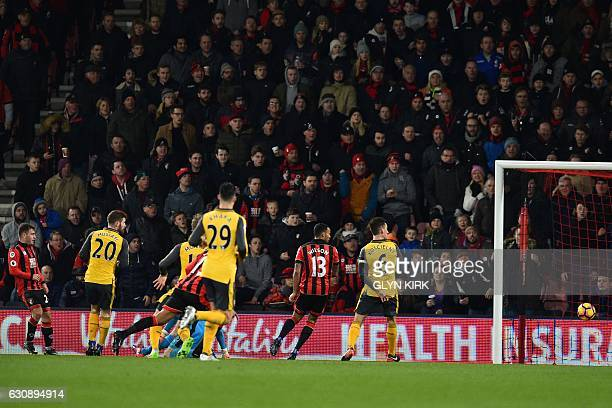 Bournemouth's Scottish midfielder Ryan Fraser watches as his shot hits the target for their third goal during the English Premier League football...