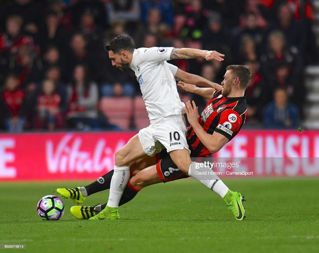 Bournemouth's Simon Francis (R) battles with Swansea City's Borja Baston (L) during the Premier League match between AFC Bournemouth and Swansea City at Vitality Stadium on March 18, 2017 in Bournemouth, England.