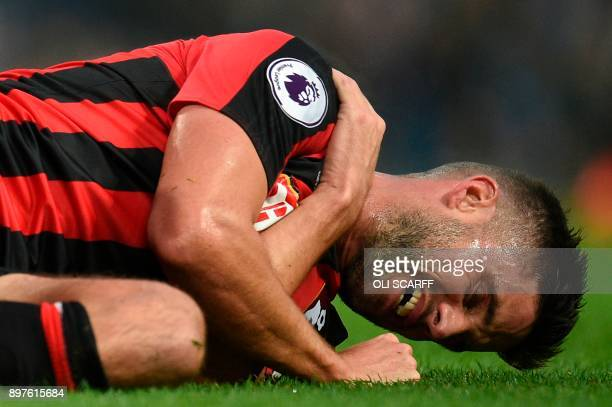 Bournemouth's South Africanborn English midfielder Andrew Surman reacts after a challenge during the English Premier League football match between...