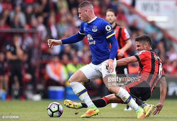 Bournemouth's South Africanborn English midfielder Andrew Surman tackles Everton's English midfielder Ross Barkley during the English Premier League...