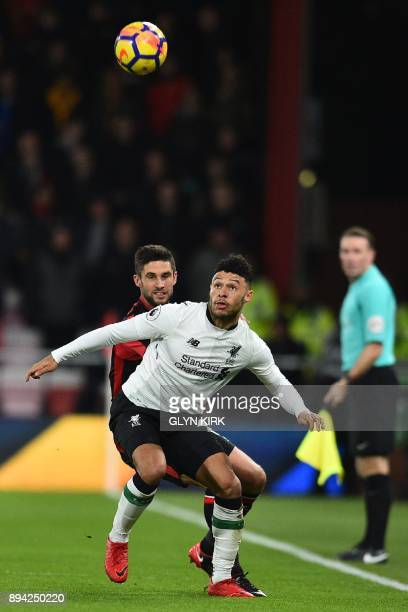 Bournemouth's South Africanborn English midfielder Andrew Surman vies with Liverpool's English midfielder Alex OxladeChamberlain during the English...