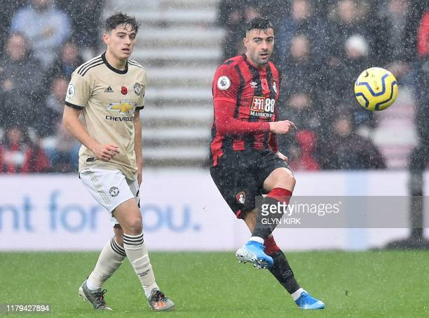 Bournemouth's Spanish defender Diego Rico plays the ball ahead of Manchester United's Welsh midfielder Daniel James during the English Premier League...