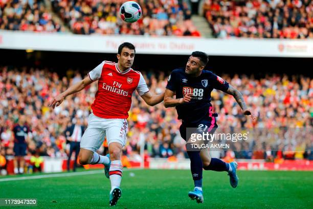 Bournemouth's Spanish defender Diego Rico vies with Arsenal's Greek defender Sokratis Papastathopoulos during the English Premier League football...
