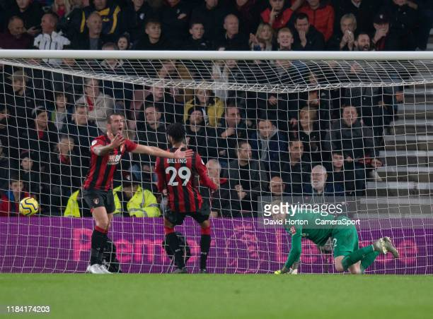 Bournemouth's Steve Cook shows his frustration and Bournemouth's Aaron Ramsdale looks on in frustration after Wolverhampton Wanderers' Raul Jimenez...