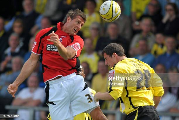 Bournemouth's Steve Fletcher and Burton Albion's Shaun Kelly battle for the ball during the CocaCola Football League Two match at the Pirelli Stadium...