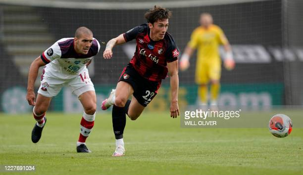 Bournemouth's Welsh midfielder Harry Wilson is challenged by Southampton's Spanish midfielder Oriol Romeu during the English Premier League football...