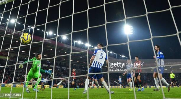Bournemouth's Welsh midfielder Harry Wilson scores the opening goal past Brighton's Australian goalkeeper Mathew Ryan during the English Premier...