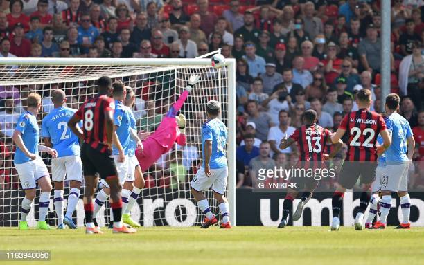 Bournemouth's Welsh midfielder Harry Wilson watches the ball from his free-kick go into the net to score his team's first goal during the English...